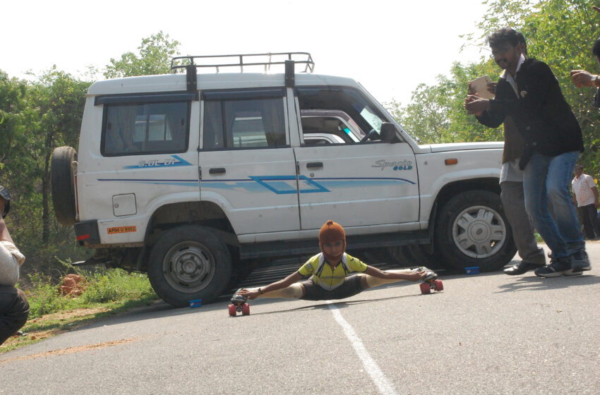 FARTHEST DISTANCE IN LIMBO SKATING UNDER CARS
