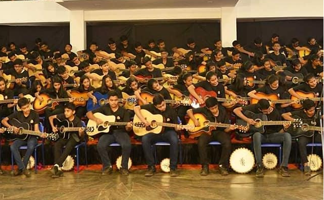 MAXIMUM STUDENTS PERFORMED NATIONAL ANTHEM ON GUITAR