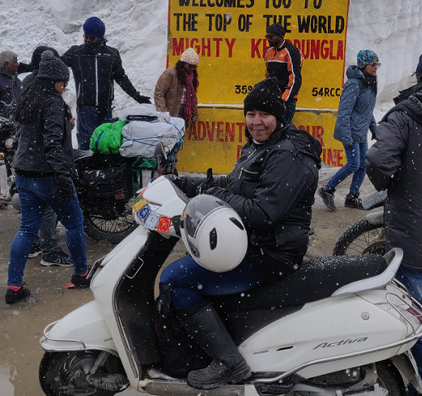 FIRST LADY TO RIDE SCOOTER ON HIGHEST MOTORABLE ROAD