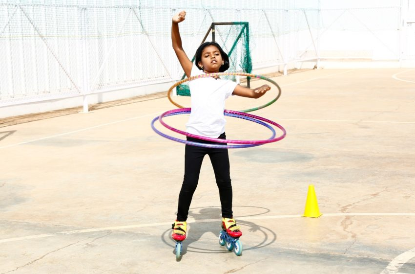 YOUNGEST TO PERFORMED SKATING WITH SPINNING THREE HULA HOOPS