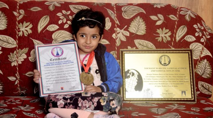 YOUNGEST TO RECITE NATIONAL ANTHEM AND NATIONAL SONGS IN TIME