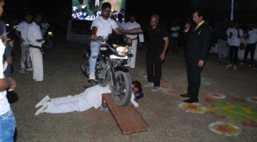 MAXIMUM NUMBER OF MOTORBIKES WILL PASS FROM HIS BACK, LYING (CHEST) TOWARDS NAIL BOARD IN ONE MINUTE