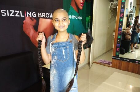 YOUNGEST GIRL TO DONATE HAIR TO CANCER PATIENTS.