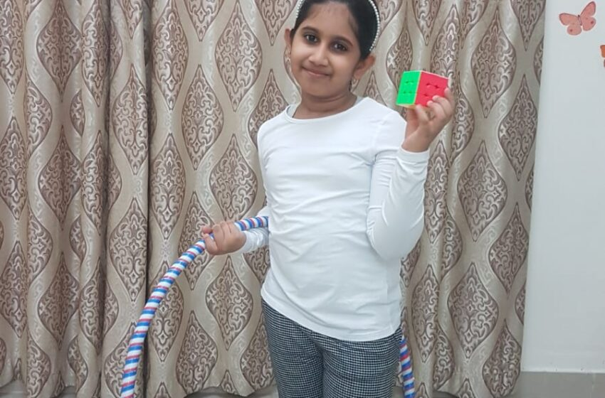 YOUNGEST KID TO SOLVE RUBIK'S CUBE WHILE PERFORMING HULA HOOPS AND RECITING INDIAN STATES ALONG WITH THEIR CAPITALS.
